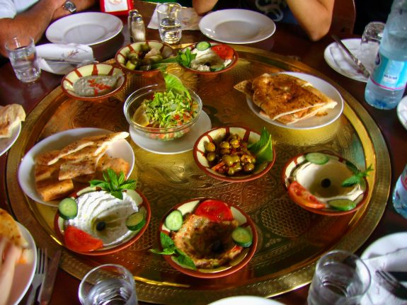 Meze is a selection of small dishes served to accompany alcoholic drinks as a course or as appetizers before the main dish in Arab countries, Turkic countries, and Iran.