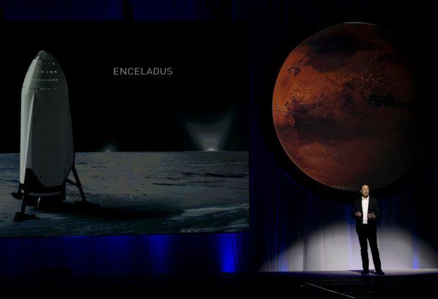 SpaceX founder Elon Musk speaks during the 67th International Astronautical Congress in Guadalajara, Mexico, Tuesday, Sept. 27, 2016. In a receptive audience full of space buffs, Musk said he envisions 1,000 passenger ships flying en masse to Mars, 'Battlestar Galactica' style. He calls it the Mars Colonial fleet, and he says it could become reality within a century. Musk's goal is to establish a full-fledged city on Mars and thereby make humans a multi-planetary species. (AP Photo/Refugio Ruiz)