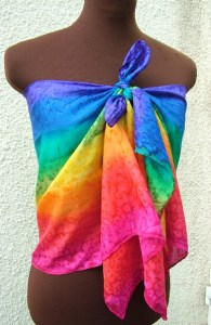 The rainbow silk scarf styled as a summer wrap