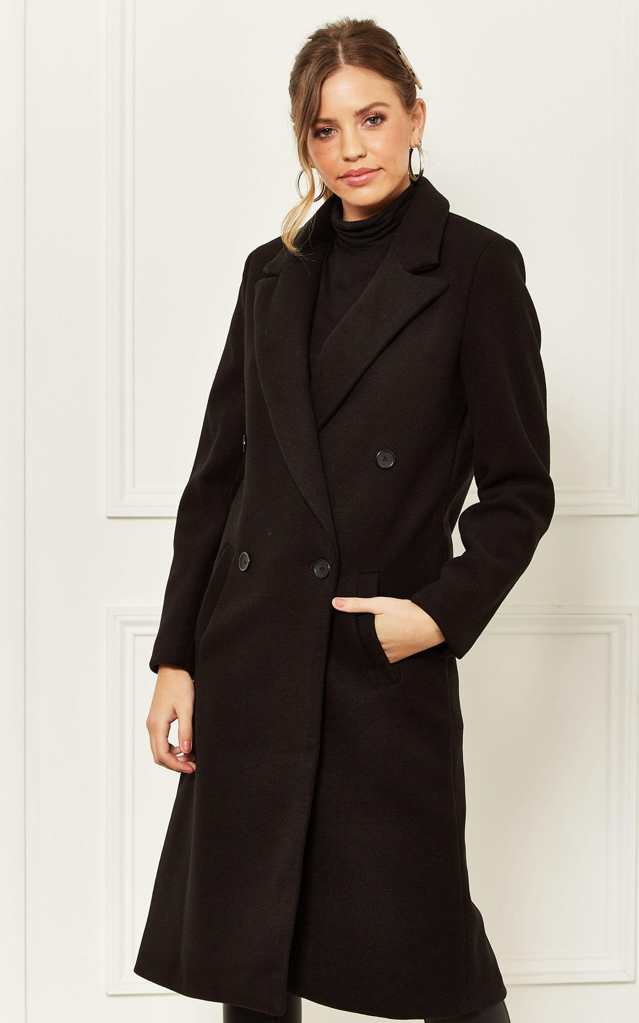 Model wears a longline black jacket