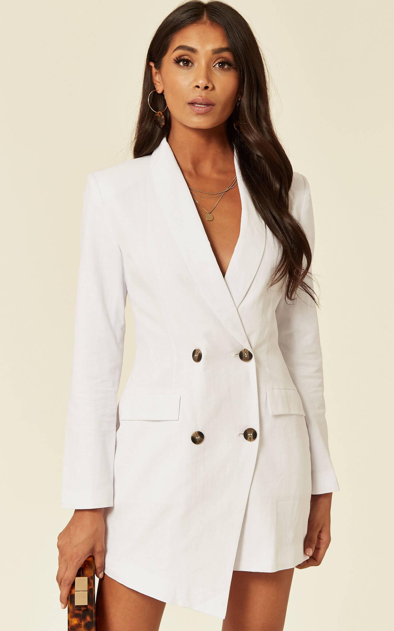 Model wears double breasted white cotton blazer dress in white