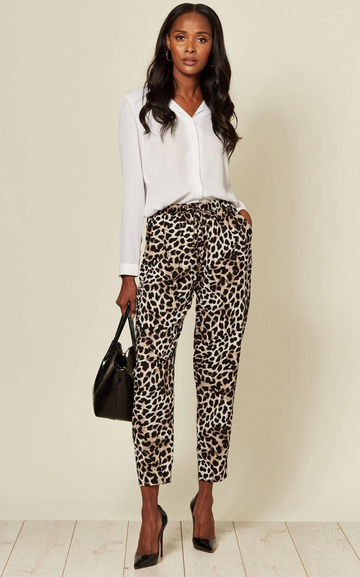 model wears smart shirt and leopard print trousers
