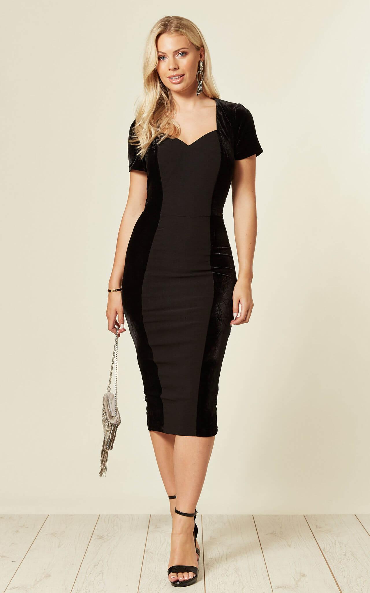 Model wears a velvet midi black dress