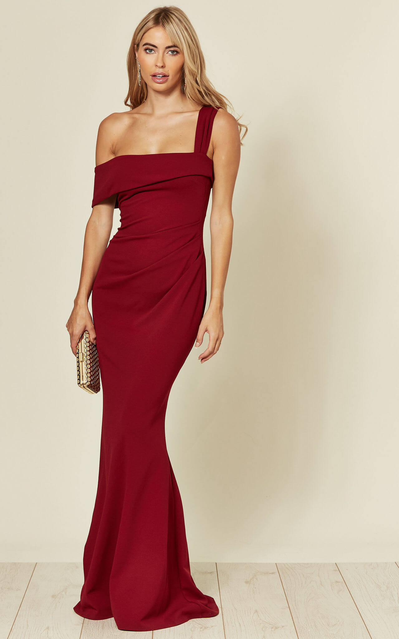 Model wears an off the shoulder maxi dress in red