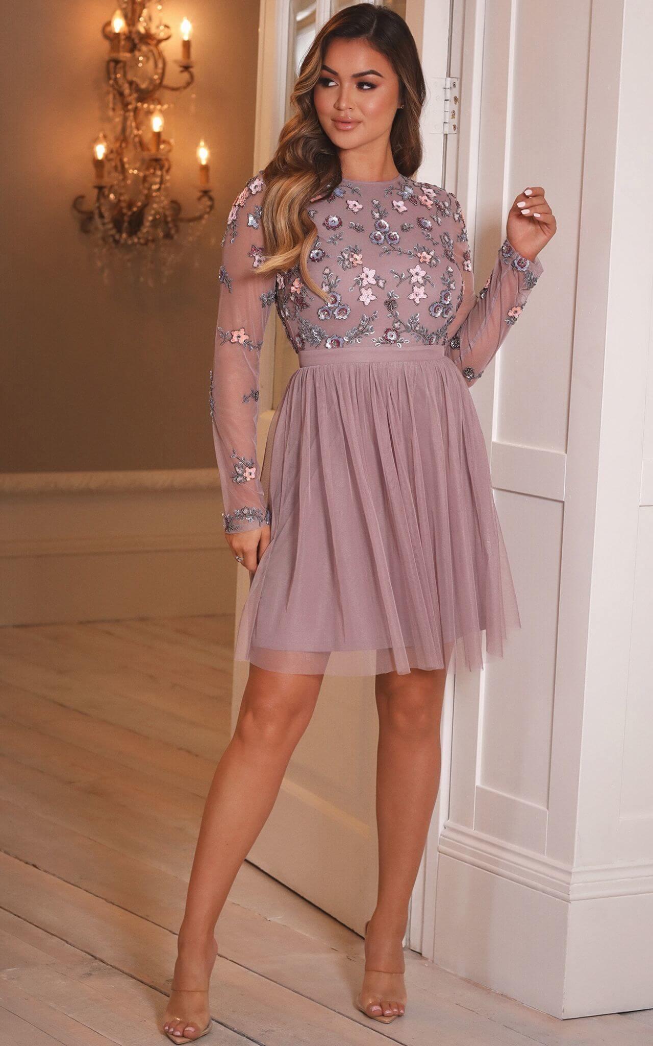 Model wears a beaded mesh skater dress in lilac