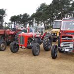 row of red tractors