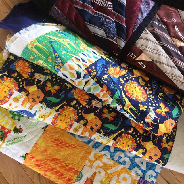 Quilts fresh from the quilter (thanks gayle) guess I have binding to do!! #hungrycaterpillar #babywilliams #origamioasis #iamadesigner happy Wednesday!