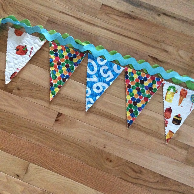 Making slow progress on #babywilliams bunting project. Summer taxi service is kicking my tail! #hungrycaterpillar #iamadesigner