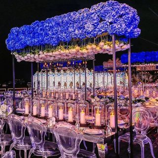 chair and tables for events with flowers