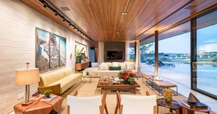 The wood slat ceiling adds warmth and elongates the room