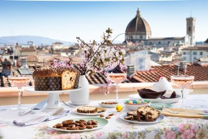 table set up with food on a terrace in Florence