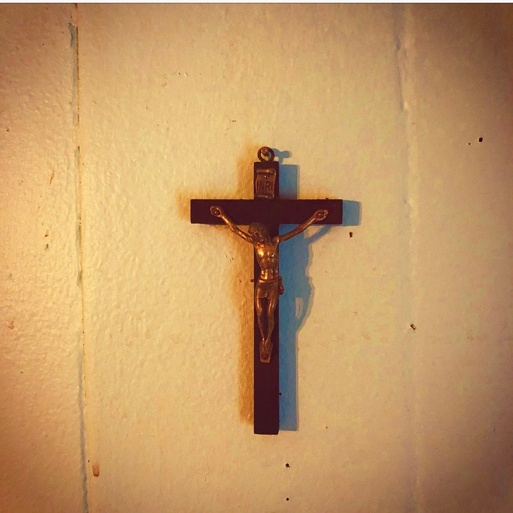 Yes, you should have a crucifix on your wall