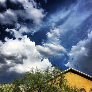 Early summer clouds above a university bungalow.