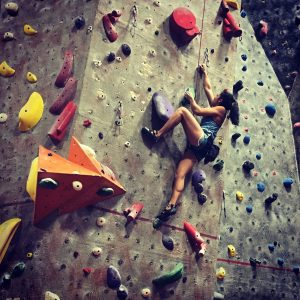 Rock climber at an indoor gym in Tucson.