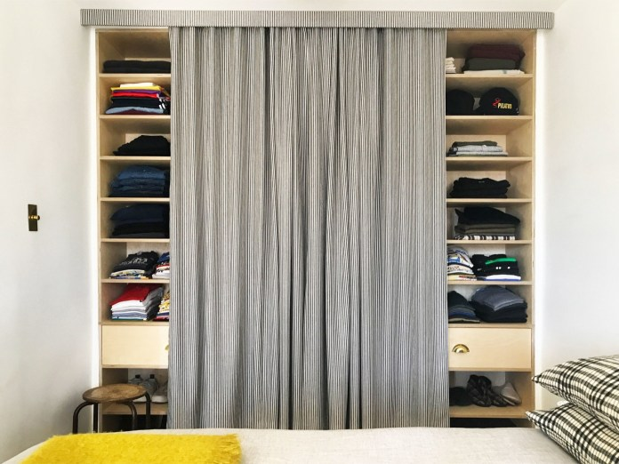 1.Cover Your Cabinets with Curtains via Simphome