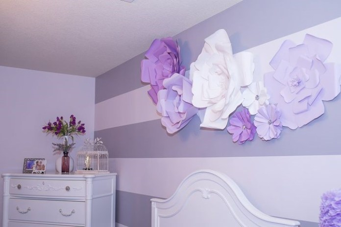 1. Accent Wall with Giant Paper Flowers via Simphome