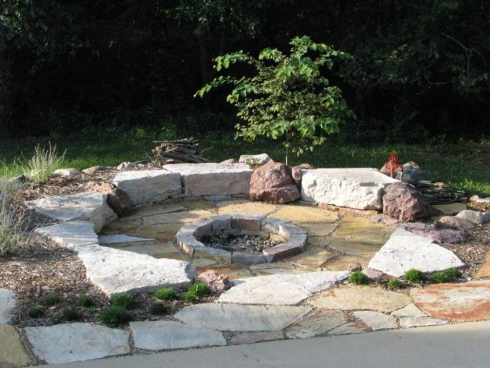 4.Stoneage Firepit Idea for a Traditional Backyard Design via Simphome.com