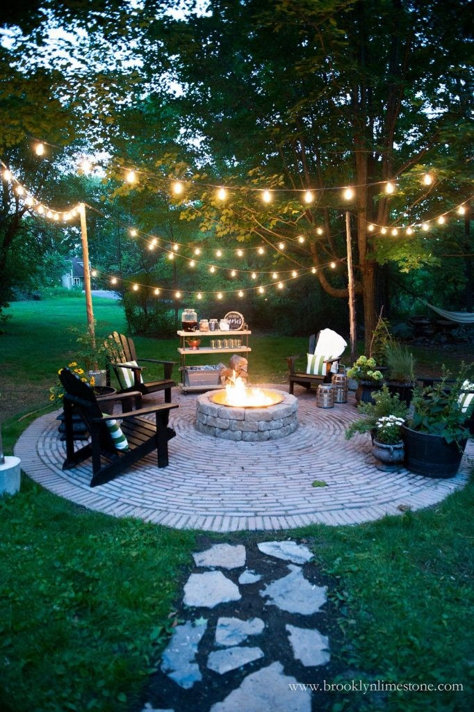 6.Modern Rustic Firepit Area with Yellow Bulbs Lighting via Simphome.com