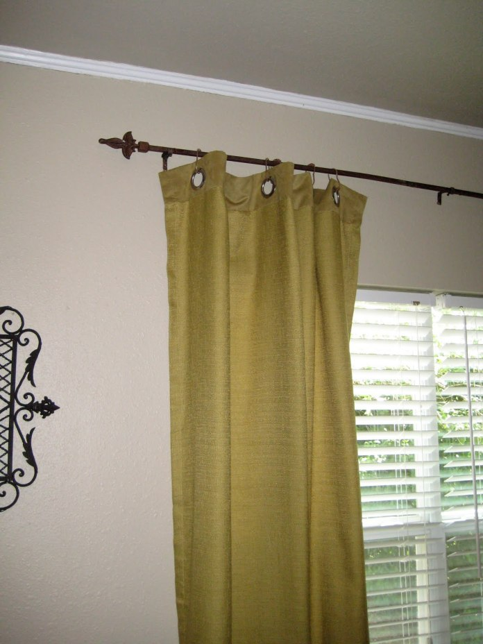 9.SIMPHOME.COM A Welded Fence Rail Curtain Rod Project Idea