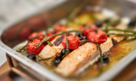 Oven baked salmon with tapenade, tomato and mozzarella topping