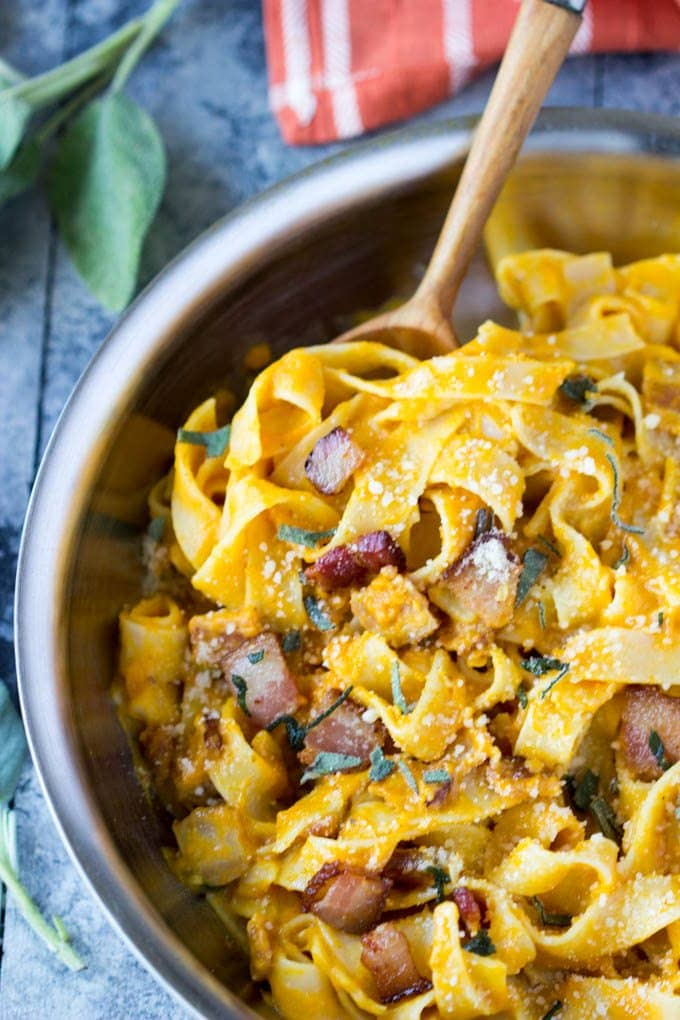 So easy! Only a few simple ingredients needed to make this healthy Fall inspired meal. Creamy pumpkin sauce tossed with fettuccine, Parmesan, bacon & sage | simplehealthykitchen.com #onepan #pumpkin # healthy