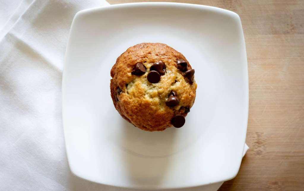 banana chocolate chip muffin on white plate