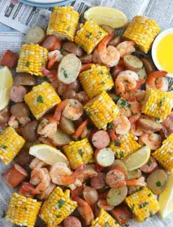 SIMPLE Cajun Shrimp Boil - shrimp, corn, potatoes, onions in a flavorful Zatarains broth #shrimpboil #oldbay #seafoodboil #simplepartyfood