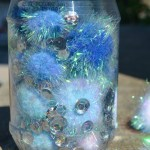 Pom pom Sensory Bottle – Frozen Inspired!
