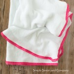 DIY Pom Pom Swaddle Blanket Tutorial