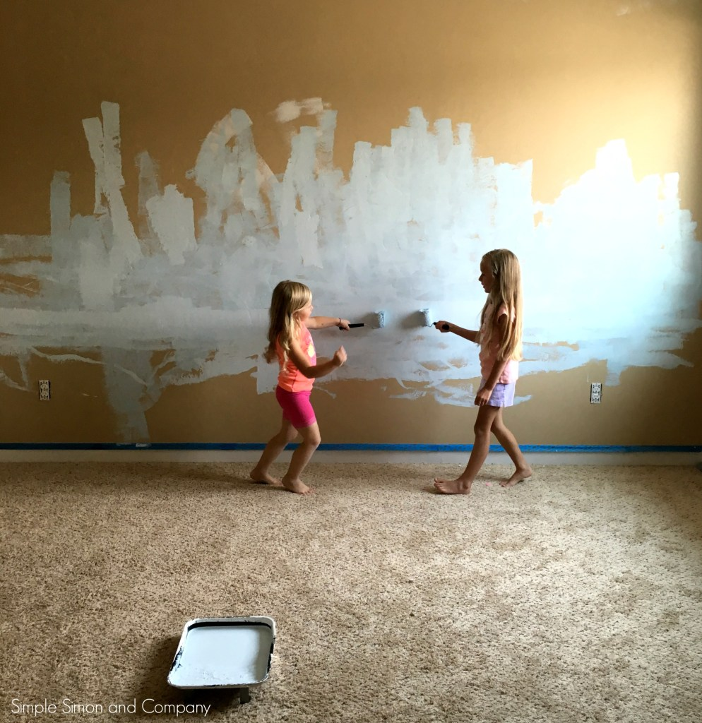 Ruth and Grace painting their bedroom
