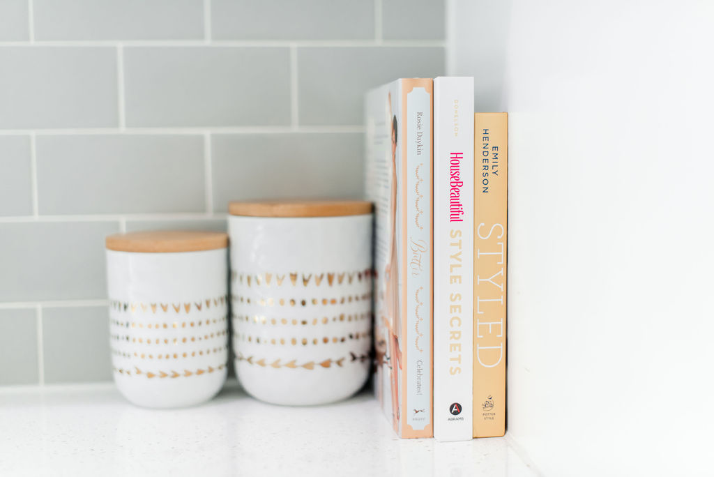 white quartz countertops with styling books