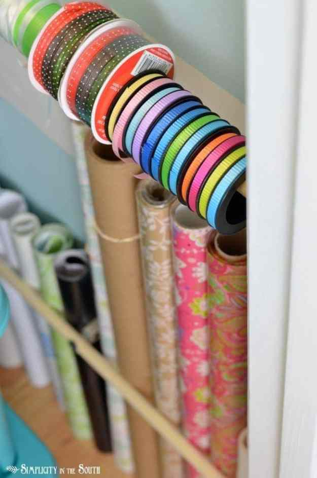 Use dowel rods and curtain rod brackets for wrapping supplies