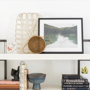 white open shelves with baskets books and pictures