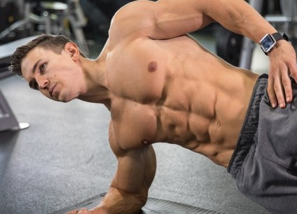 a picture of a gym goer doing the plank ab exercise