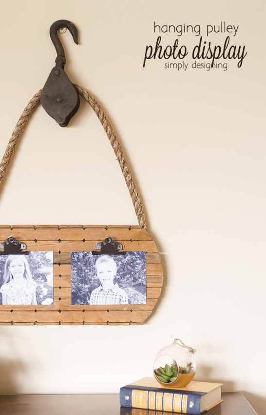 hanging pulley photo display - this is such a great way to resuse a vintage pulley and a few thrift store finds