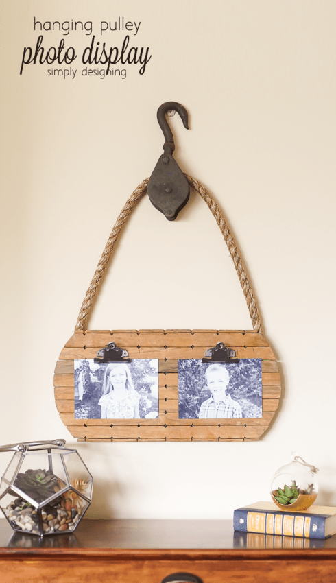 hanging pulley photo display - you wont believe the thrift store finds I made this from