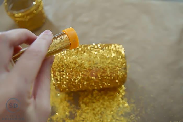 DIY Gold Glitter Mason Jar Luminaries - add glitter