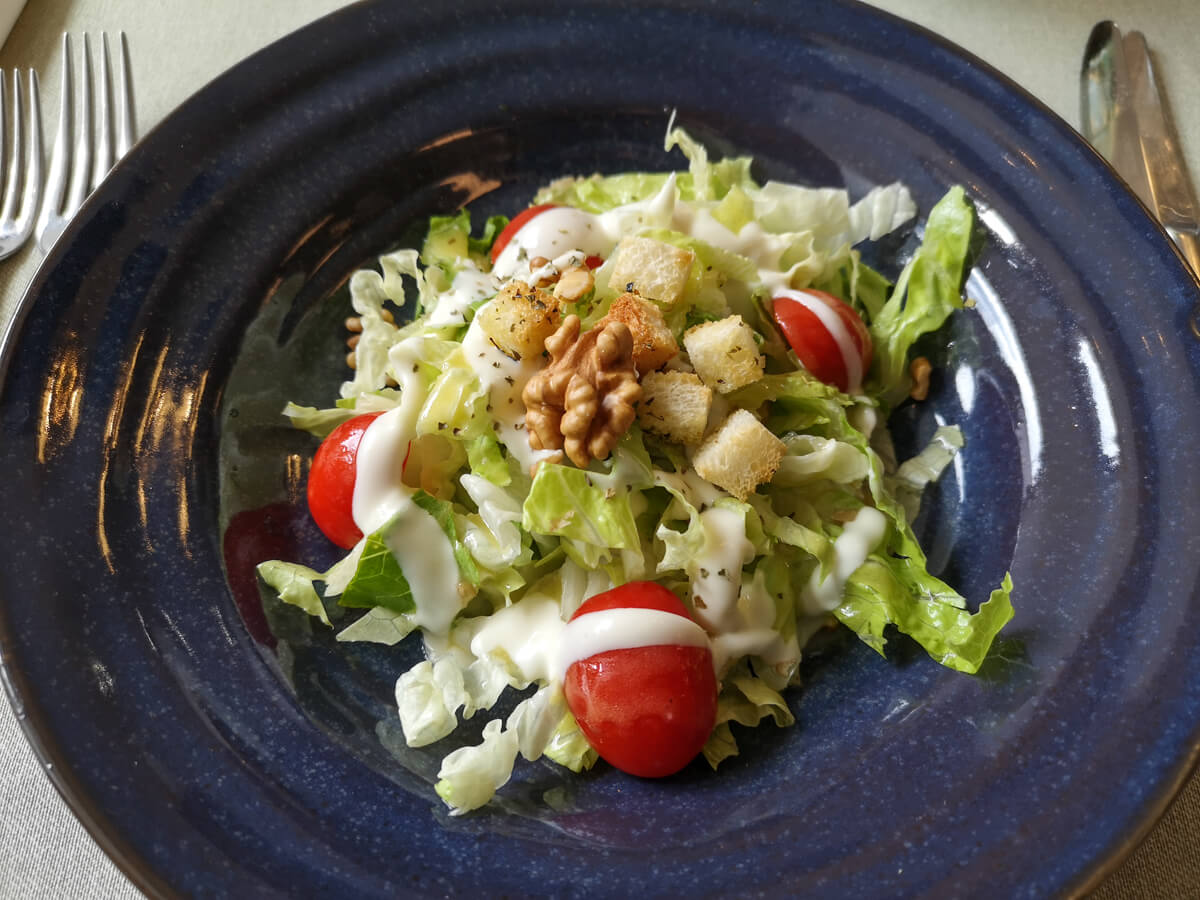 A blue plate of salad.