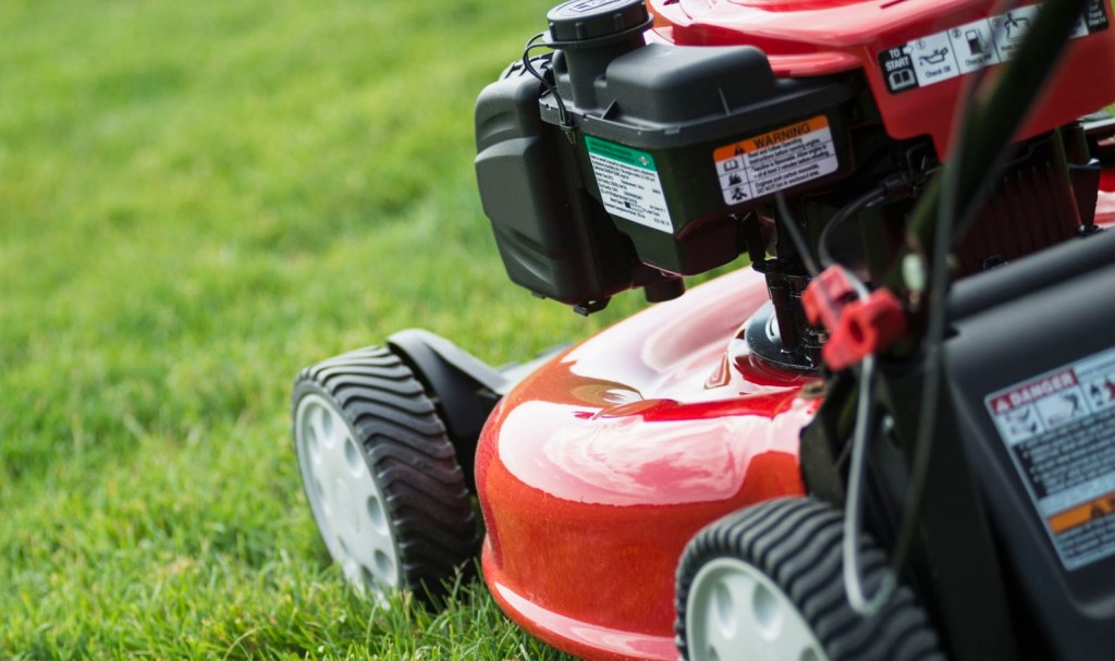 Gas Lawn Mower cutting grass