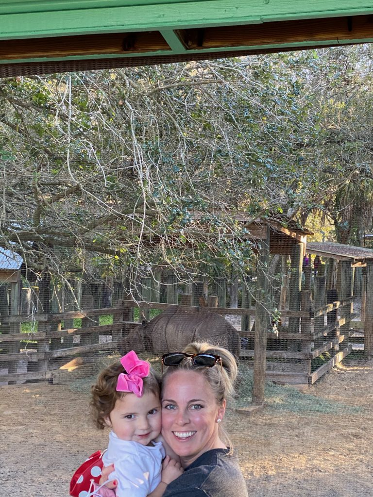 Caroline and Holley at the zoo by the rhino