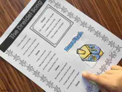 Use holiday songs like the Dreidel Song to work on reading with your students. Free printables from Simply Kinder.