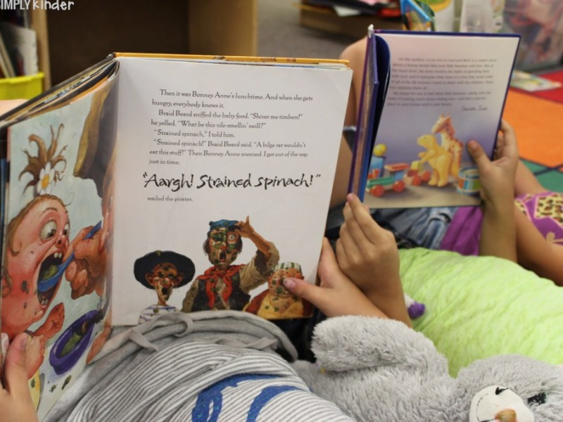 Students reading using their new keepsake pillowcases!