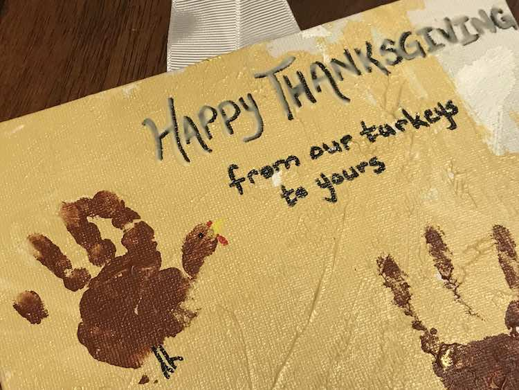 """Wrote the text with an oil-based paint pen and then went over the """"Happy Thanksgiving"""" with a fine tipped bottle of glow paint."""