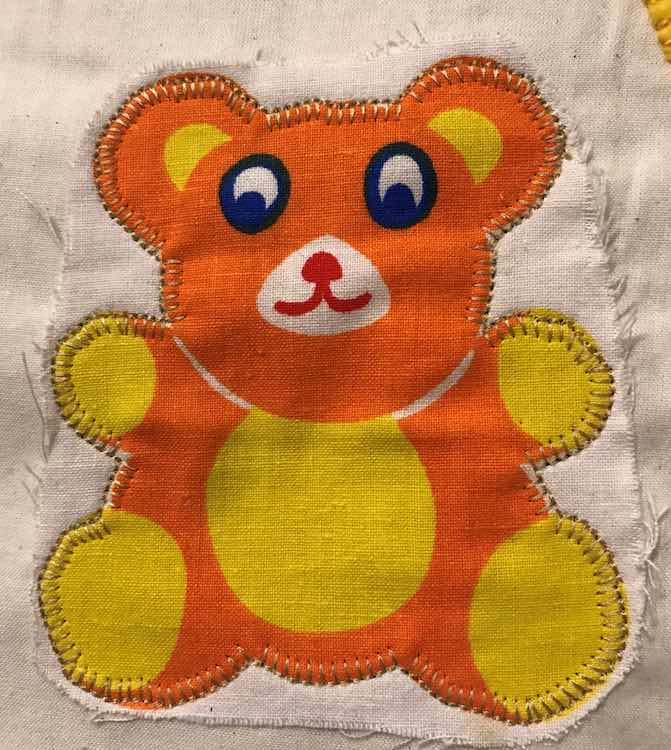 Pinned and sewed the teddy bear onto the page.
