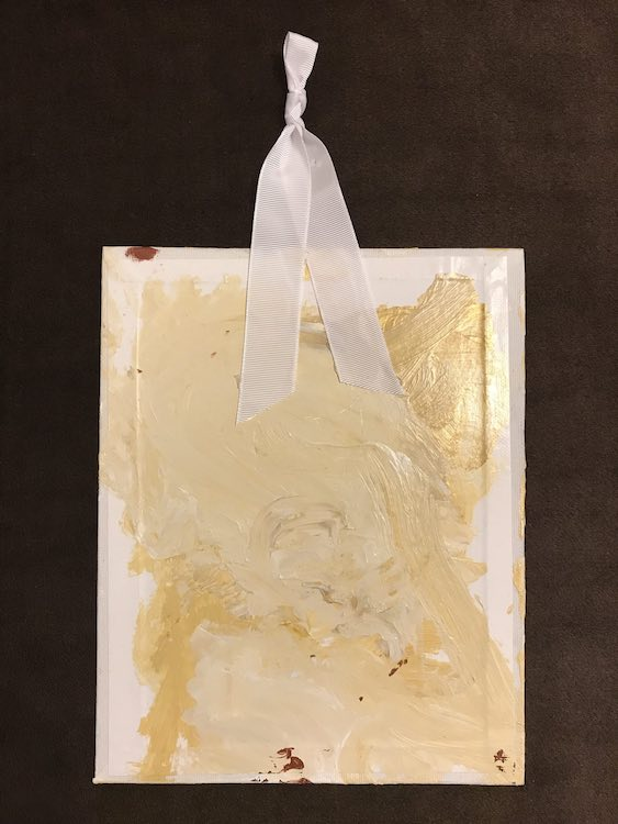 When it's all dry you can use a glue gun to attach a ribbon to hang the canvas.