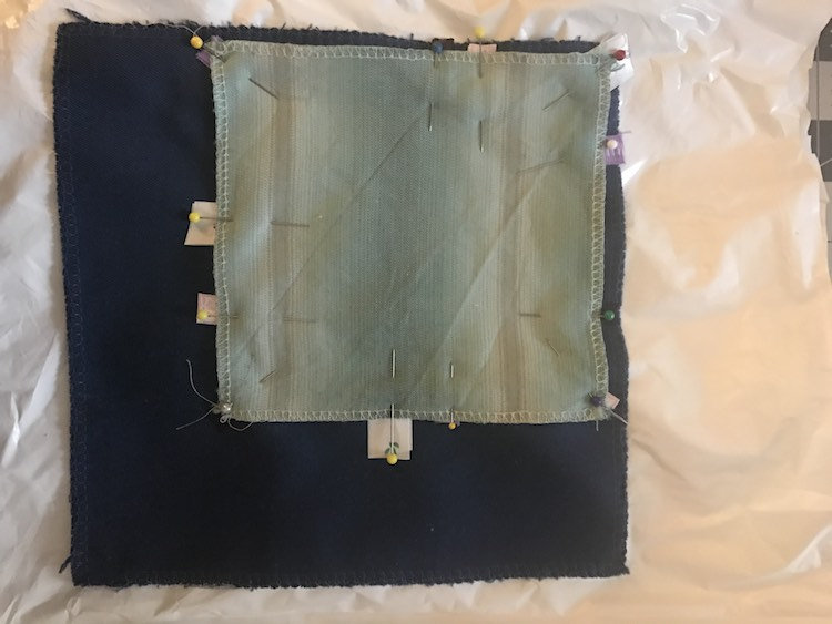 Stack your elements. Make sure the outside fabrics are facing right side together and the ribbons are tucked inward in between. The crinkle element will be on the inside so stack it on the bottom or top. Pin in place.