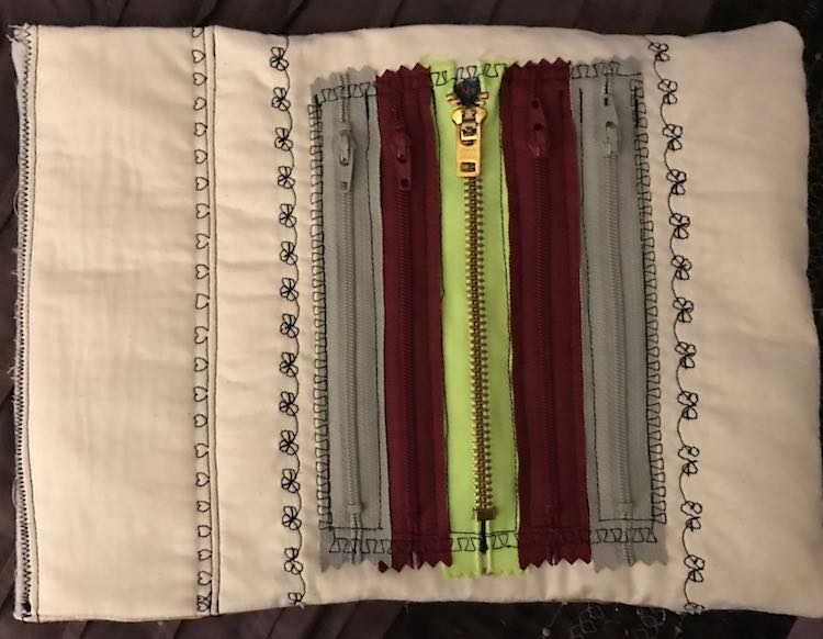 Finished zipper fun quiet book page.