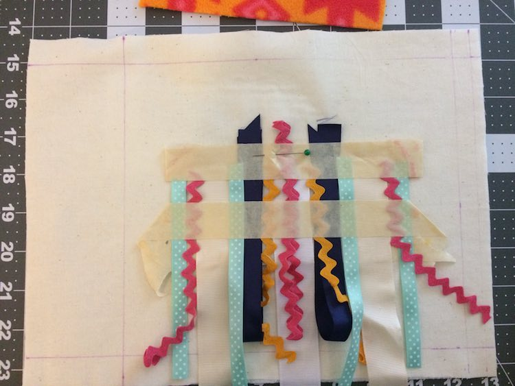 Lined up the ribbons on the quiet book page base while making sure there's room for the jellyfish top.