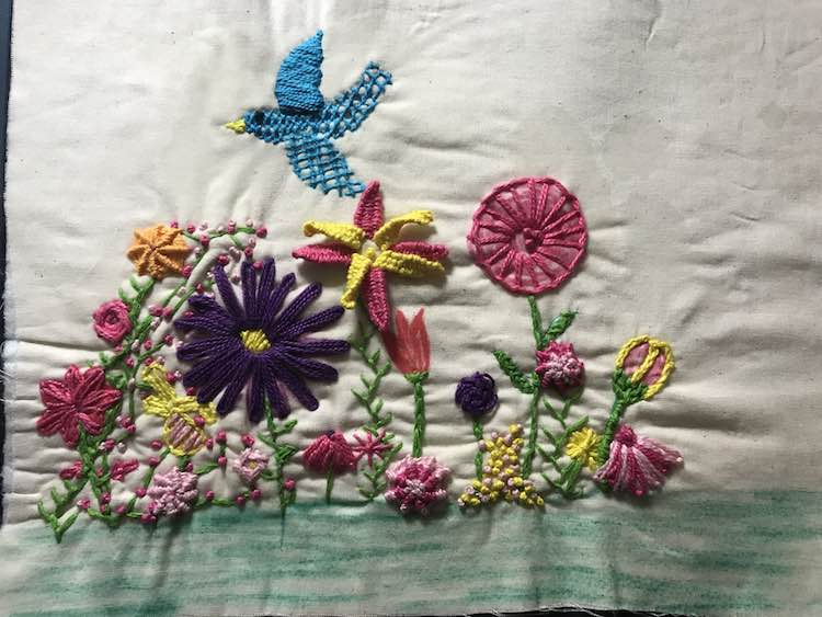 I then filled in the blank spaces in the garden with more stitches and colors. I decided to keep the grass unembellished to compliment the page yet not detract from the garden.