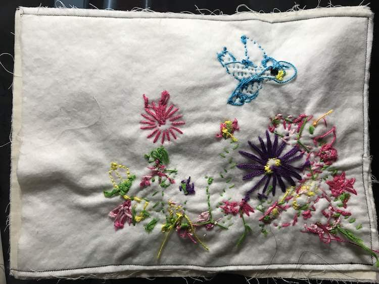 Sewed around three sides leaving the grommet end open.